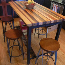 Evan's Kitchen - This modern mix of industrial iron and a colorful selection of reclaimed hardwoods is the ultimate butcher block kitchen island, great for prepping dinner or enjoying a slow glass of wine!