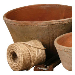 "Rustic Terra Cotta Oval Pot - 3"" x 5"" - Unique touches, created both by simple age and weathering and by the hand of the craftsman, add to the old-world impact of the Rustic Terra Cotta Oval Pot in Antique Red. This accessory was handmade and then allowed to acquire a natural patina in order to make its presence in your home graceful and unconventional despite the familiarity of its warm, earthy red clay tone."