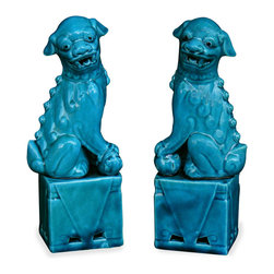 """China Furniture and Arts - Porcelain Blue Foo Dogs - As fantasy lions of Chinese mythology, Foo Dogs always stand in pairs to serve as guardians to prevent harmful things from happening to the family. This pair is painstakingly hand made by skilled craftsmen in China. Great to display on a mantel or side table as a symbolic Asian accent. Each one is 3.5""""L x2.5""""W x10.75""""H"""