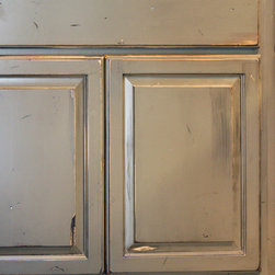 Cabinets - Premium Custom Finishes - Photo 3:  Close-up view of premium custom color accented with hand-glazing and heavy hand-distressing. Photo by Brad Richard