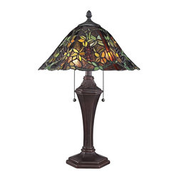 "Quoizel - Tiffany Quoizel Liana Tiffany Style Table Lamp - The hauntingly beautiful shade of this Tiffany style table lamp features a blend of dark and bright glass in a splendid floral pattern. Scalloped bottom edges add to its organic feel. The fittingly detailed russet finish metal base enhances the authenticity of this iconic home accent. Two lights are controlled by dual pull chains. This elegant Quoizel lamp will warm your home with its enduring glow. Sophisticated dark glass table lamp. Rich Russet finish. Metal construction. Round multicolor art glass shade. Shade constructed of 462 pieces of stained glass. Two max 75 watt bulbs (not included). 24"" high. Shade is 16"" wide.   Sophisticated dark glass table lamp.  Rich Russet finish.  Metal construction.  Round multicolor art glass shade.  Shade constructed of 462 pieces of stained glass.  Two max 75 watt bulbs (not included).  24"" high.  Shade is 16"" wide."