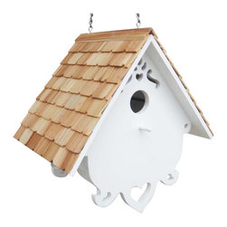 "Home Bazaar Inc. - Love Nest House - White/Natural - This hanging house is designed to accommodate house wrens, one of the only species that tolerates a swinging nest box! It has a roof covered with notched pine shingles, a removable bottom panel for easy cleaning, a 1 1/4"" entry hole to an unpainted nest box, ventilation and drainage holes. Features: heart shaped scrollwork; and paisley cut outs."