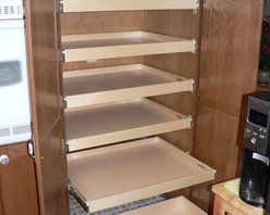 Cabinet Pantries - ShelfGenie of Seattle will design and install a custom pull out shelving system for your home.  Shown here is a cabinet pantry that has just had pull out shelves installed.