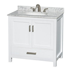 Wyndham Collection - Wyndham Collection WCS141436SWH Sheffield 36-in. Single Bathroom Vanity - White - Shop for Bathroom Cabinets from Hayneedle.com! Your sink will be the center of the washroom so whether you're remodeling or just looking for a simple change the Wyndham Collection WCS141436SWH Sheffield 36-in. Single Bathroom Vanity - White is a strong move when setting your bathroom style. This solid-wood vanity is offered with multiple choices for the undermount sink and vanity top giving you the ability to customize it to fit your taste. You even have the option of purchashing this vanity without a sink or top if you already have something in mind. The wood body is prepared and finished with a 12-step process that gives you a warp-free moisture-resistant body with an elegantly simple white finish. A single deep drawer slides on fully extendable metal glides and sits beneath a large open storage compartment that's covered by a pair of double doors. Both the drawer and doors close on soft-close latches. The vanity is pre-drilled for either a single-hole or 3-hole faucet.Product Dimensions:Vanity dimensions with top: 36W x 22D x 35H in. About the Wyndham CollectionWyndham and the Wyndham collection are all about refinement detailing uniqueness quality and longevity. They are dedicated to the quality of their products and own the factory where each piece is constructed. This allows Wyndham to offer products that reflect the rigorous quality standards required for every piece that is offered to their customers. The Wyndham collection showcases elegant modern design styles that highlight functionality and style in every detail.