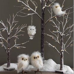 """24"""" Flocked Lit Tree - Battery Operated - Our twiggy tree features a windblown look with 36 warm white led lights and a touch of snow. Perfect for creating a holiday landscape on your buffet, mantle or childs room. In fact, my granddaughter thinks it makes the perfect barbie tree. Features include an on/off and timer switch for a 6 hour timer that repeats every 18 hours. Indoor use only. Requires 3 AA Batteries. Lights approx 30000 hours."""