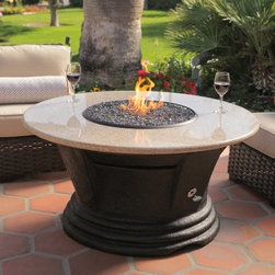 California Outdoor Concepts San Simeon Round Chat Height Fire Pit Table - The California Outdoor Concepts San Simeon Round Chat Height Fire Pit Table puts traditional patio furnishings and tiki torches to shame! You'll want to entertain more than ever before with this round table that showcases a durable resin base with molded sides and a tiered bottom inspired by the majestic castle of its namesake. Its round top is crafted entirely from natural stone with a burning bowl at its center that provides both warmth and inviting ambient light for your next outdoor gathering. The eye-catching blaze is made possible by a 40 000 BTU stainless steel burner that runs on a 20 lb. liquid propane tank (sold separately) hidden within the decorative base. For a finishing touch customize your table with either realistic gas logs and lava rocks that cover the burner or your choice of colorful fire glass. Runs on propane and/or natural gas conversion kit for natural gas is included. About California Outdoor ConceptsCalifornia Outdoor Concepts builds their fire pits and accessories exactly where it would seem - in the sunny climate of idyllic California. By living the lifestyle they sell this small company is able to develop some of the most sophisticated beautiful and practical designs for outdoor socializing. There are no assembly lines at the COC production facility - each piece is handmade and checked for perfection. When you're ready to heat things up in your backyard trust in the true California way.