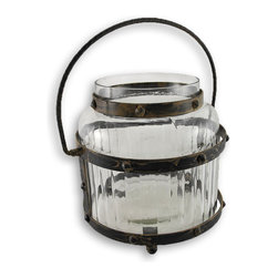 Zeckos - Traditional Glass and Metal Candle Lantern - Close to nothing beats the warmth and mellow glow of this unique glass candle lantern It is a traditional light source that adds rustic and old world charm to your home, garden or patio. The glass is designed with appealing horizontal 'strips' that help ensure broad illumination. The metal frame looks as if it's bolted to the glass, yet removes easily to aid in ease of cleaning. The stylish metal handle and frame sport a tarnished and worn finish to complete the authentic antique feel. The body of this lantern is made from high-quality, thick glass and is roomy enough to allow up to a 5.5 inch diameter candle, or use several smaller or varying sized candles for an aesthetic and artistic illumination source. This elegant glass lantern blends easily with any decor style. This would make a wonderful centerpiece accent in any outdoor setting, and would summon a warm sensation on a cool crisp evening.