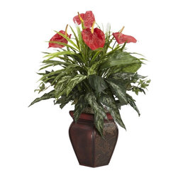 Mixed Greens and Anthurium with Decorative Vase Silk Plant - For any sharp-eyed plant lover, the first thing that is bound to be noticed is the sheer amount of variety of texture and color found in this piece. This silk plant is a veritable cornucopia of greenery, neatly complimented by the vibrant red plumage on top. This plant is the right choice for anyone who likes to make a statement without saying a single word. Arrives with an elegant vase for that added touch of class. Height= 26 in x Width= 22 in x Depth= 20 in