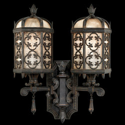 Fine Art Lamps - Costa del Sol Outdoor Double Wall Mount - Costa Del Sol Outdoor Double Wall Mount features two-arm perched bottom wall mount in stylized quatrefoil design features Marbella wrought iron finish and subtle iridescent textured glass. Two 60-watt, 120 volt A19 medium base incandescent bulbs are required, but not included. Dimensions: 17W x 21H x 8D.