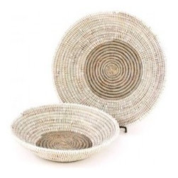 Sengalese Bread Basket - This bread basket combines resourcefulness with beauty. Senegalese women weave these creations using cattails and plastic. The baskets are then fairly traded to support the women and their families. Now that's a kitchen necessity you can really feel good about!