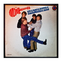 """Glittered Monkees Headquarters Album - Glittered record album. Album is framed in a black 12x12"""" square frame with front and back cover and clips holding the record in place on the back. Album covers are original vintage covers."""