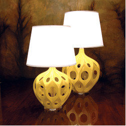 New Lamps Yellow Truffault Lamps - I love the futuristic sculptural shape of these French New Wave inspired bright ceramic lights. I also love the color, but if you're not digging it, they also come in black and white.
