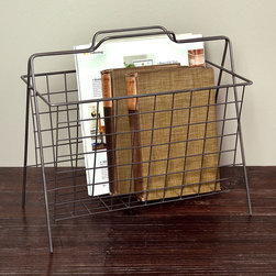 Darby Wire Magazine Basket - Eloquently simple style comes to living spaces and libraries with the transitional Darby Wire Magazine Basket, an angled and austere rack for your reading material or other goods you want kept close to hand. The steel grid that holds up the contents has an airy, weightless look, making this an ideal piece for keeping a room organized, yet looking spacious and updated.