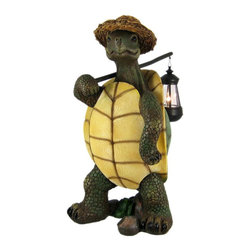 Funny Country Turtle W/ Lantern Statue Outdoor Figure - This wonderfully detailed country turtle outdoor statue carries a lantern that holds a battery powered accent light Made of cold cast resin, the turtle measures 17 1/4 inches tall, 8 inches wide and 12 inches deep. He`s hand-painted, and shows great detail. The lantern opens from the bottom, allowing you to change out the 2 AA batteries when needed.  This statue makes a wonderful gift for any turtle lover.