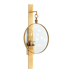 Templeton Wall Candleholder - Influenced by the wall sconces that grace European libraries, the Templeton Wall Candleholder boasts a minimalist design that is simple in form yet dramatic in beauty. A single candleholder is beautifully framed by a gold ring suspended from a simple bracket; as all are finished in gold leaf, this accent piece offers a suggestion of old-world glamour.