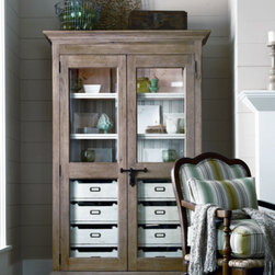 Universal Furniture - Paula Deen Dish Pantry in Oatmeal - Looking for a China cabinet change-up? Then the Paula Deen Dish Pantry, by Universal Furniture, is for you! Behind the beautifully wood-framed doors lies an abundance of storage. Eight interior tray drawers, with silverware tray inserts in the top, provide ample space for even the most expansive serving sets! The slatted back, poplar veneers, and weathered oatmeal finish combine to give this piece an old-world feel without sacrificing modern functionality.