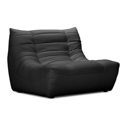 ZUO MODERN - Carnival Single Seat Black - Like curling up in someone's arms, the Carnival sectional set is wrapped in a soft leatherette, padded and tufted in all the right ways. Comes in espresso, black and white.