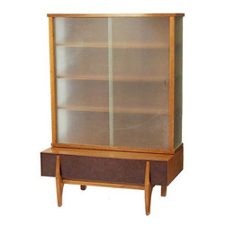 John Keal - Pre-owned John Keal Wall Unit or Vitrine with Drawers - This versatile mid-century modern vitrine or wall unit designed by John Keal for Brown Saltman features four shelves behind original sliding glass doors atop a sculpturally rendered two drawer storage unit.    The matching credenza/buffet is also available from this seller, as well as other John Keal pieces. Please contact support@chairish.com for further details.
