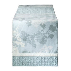Home Blue Floral Quilted Table Runner - Something as easy as adding a runner can bring a fresh touch to your seasonal decor. We love how this just captures the essence of winter with its icy blue tones and simple branch pattern.