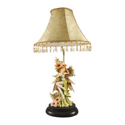Zeckos - Beautiful Flower Fairy Table Lamp with Shade - This adorable table lamp is a great addition to bedrooms, hallways and living rooms. Made of cold cast resin, the lamp features an earth-toned fairy in a long green skirt nestling up against some flowers. The lamp measures 19 inches tall (with the golden flowered shade accented with hundreds of beads), and the shade is 10 inches in diameter. The detail is incredible, down to the ivy wrap on her left thigh. The lamp takes standard light bulbs up to 60 watts. It comes with a 5 foot power cord with a thumb wheel toggle switch shell make a fine gift for any fairy lover.