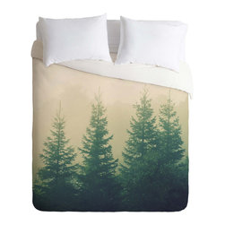 Winter Pines Duvet Cover - This gorgeously chic duvet cover will bring about compliments all year round. Cozy and bold, the evergreen pine print looks great paired with earthy tones and rustic wood. Dare to contrast with seasonal berry-reds and rusts for a warm and inviting look that will inspire all your guests to stay longer.