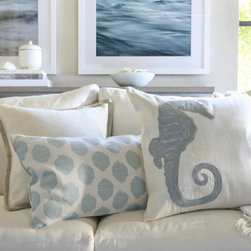 Seahorse Pillow Collection - Seahorses are always a part of quintessential beachy motifs. The pale blue of this pillow collection makes it easy to incorporate into your existing decor.