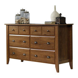 Sauder - Sauder Shoal Creek Dresser in Oiled Oak - Sauder - Dressers - 410287 - Contemporary meets rustic in this dresser from the Sauder Shoal Creek collection. Drawers feature metal runners and safety stops, allowing you to use this in even the busiest of households. The assembly couldn't be easier with the patented T-slot drawer assembly system. As an added bonus, the four lower drawers are extra-deep, ensuring that all of your storage needs will be met in one beautiful piece of furniture. Finished in a beautiful Oiled Oak, there is no doubt that this mirror will be a staple in your child's bedroom, master bedroom, or guest room for years to come.