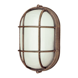 Transglobe - Trans Globe 41005 Bulkhead - 5.25W in. - 41005 RT - Shop for Home Furnishings and Accents from Hayneedle.com! The Transglobe 41005 Bulkhead - 5.25W in. has a clean functional style that will make a positive and modern addition to any home. The body of this durable fixture is made from corrosion-resistant cast aluminum with a finish that gives it the look of rusted metal. The ribbed glass shade covers a single 60-watt medium base bulb.About Trans Globe Lighting Inc.Born from the hopes and dreams of two entrepreneurial spirits in 1986 Trans Globe Lighting offers one of the most comprehensive and stylish collections of residential lighting in the world. This family-owned company based in North Hollywood Calif. is marked by personal involvement with a wide variety of products available at the lowest prices. From traditional to ultra-contemporary in style Trans Globe has just the right light for you.