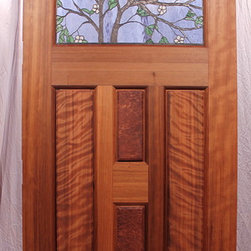 """The Dogwood Entry - The Dogwood Entry is a 36""""x80"""" arched top Old Growth Redwood Door with 2-16"""" sidelights.  The door has a copper foiled stained glass window of flowering Dogwood designed by Zoleta Lee Designs."""