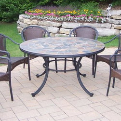 Oakland Living - Tuscany Stone Art 7-Pc Outdoor Dining Set - Includes table and six arm chairs. Fade, chip and crack resistant. Solid and sturdy yet trendy designs. Brass hardware. Warranty: One year limited. Made from natural stone, tubular iron with all weather resin wicker. Hardened powder coat finish in black. Minimal assembly required. 54 in. Dia. x 29 in. H. Overall weight: 234 lbs.Our stone art dining sets will be a beautiful addition to your patio, balcony or outdoor entertainment area. Stone art dining sets are perfect for any small space or to accent a larger space. The Oakland Stone Art Collection combines natural stone and modern designs giving you a rich addition to any outdoor setting.