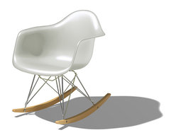 Herman Miller - Eames Molded Plastic Rocking Chair - The Eames molded plastic chairs are as beloved today as when they were first introduced in 1948. The classic design of this Molded Plastic Armchair was developed by Ray and Charles Eames during World War II. The design is true to the original but this Herman Miller production now features eco-friendly materials in the from of a recyclable polypropylene shell. This somewhat unusual chair design works beautifully and provides the same comfort the Eames Molded Plastic Armchair has provided for decades but with the added twist of a rocking chair.