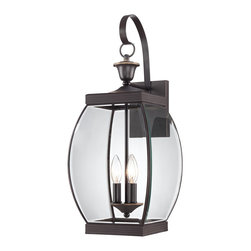 Quoizel - Quoizel OAS8409Z Oasis Transitional Outdoor Wall Sconce - This transitional collection complements many architectural styles and gives the exterior of your home both beauty and a sense of style.  It has clean lines that allow the clear beveled glass to have optimum light output.  The Medici Bronze finish completes the look of this series.