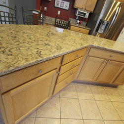 Kitchen Updates, Copley, OH #1 - In this kitchen, we updated the existing cabinets by installing Cambria 3cm Quartz countertop In Bradshaw color and Legend Titan 6x6 Porcelain tiles with Bliss Linear Silver Aspen Blend accent backsplash.  Also installed was a new Blanco Diamond equal bowl sink in biscotti color with Delta Cassidy single pull down faucet in Artic stainless finish.