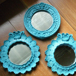 Vintage Resin Mirrored Frames - Ten bucks buys you a collection of turquoise resin mirrors that have a feminine, flirty style. That's a serious steal for a set of mirrors that will instantly dress up any space.