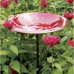Red Enamel Birdbath With Wrought Iron Twist Stake - I love the bright shiny glow if this birdbath. It sits on a wrought iron stake that almost melts into the flower bed while the enamel red bowl stands out like a flower.