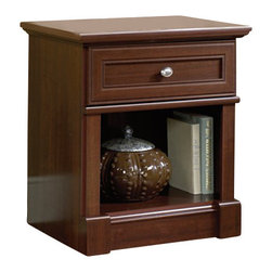 Sauder - Sauder Palladia Night Stand in Cherry Finish - Sauder - Nightstands - 411835 - A timeless classic style balanced between the past and the unique needs of the contemporary world. Designed around the universal architectural principals of symmetry the Palladia Collection rediscovers past insights and solutions that remain vital and relevant today. The collection features half and full round architectural columns and accented by handsome plinths throughout. Finished in Select Cherry, each piece features framed doors that are wrapped by a classic profile and crowned by decorative oval nickel knobs. No matter what you select, your piece will attractively house everything from media to office files with plenty of drawers, shelves and places to organize. Whether your furniture needs are for the home office, bedroom or simply a place for your new HDTV, Palladia offers a relevant solution for all.