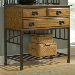 HomeStyles - Oak Hill Buffet Server in Distressed Oak Fini - Two utility drawers. Large bottom drawer provides ample storage area. Matching arts and crafts style hardware. Stylish metal base. Made from ash solids and oak veneers. Antiqued bronze frame color. 36 in. W x 18 in. D x 34 in. H. Assembly InstructionsThe Oak Hill Buffet has an updated mission styling that can make your dining room warm and inviting. The surface is protected by a clear coat finish to guard against wear and tear stemming from normal use.