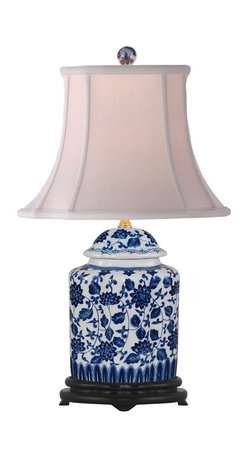 """Lamps Plus - Asian Blue and White Floral Scalloped Porcelain Tea Jar Table Lamp - This exquisite table lamp looks great in a living room or bedroom and is perfect for traditional or Asian-themed decors. It features a scalloped tea jar base decorated with a charming blue and white floral pattern. An off white French oval shade sits on top. Three-way socket gives you more lighting control. Porcelain base. Blue and white floral pattern. Off white French oval shade. Takes one 100 watt 3-way bulb (not included). 22"""" high. Shade is 7""""x9"""" across the top 13""""x14"""" across the bottom 11"""" high.  Porcelain base.   Blue and white floral pattern.   Off white French oval shade.   Takes one 100 watt 3-way bulb (not included).   22"""" high.   Shade is 7"""" wide by 9"""" deep across the top.  Shade is 13"""" wide by 14"""" deep across the bottom.   Shade is 11"""" high."""