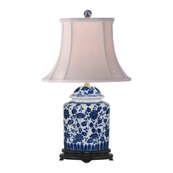 "Lamps Plus - Asian Blue and White Floral Scalloped Porcelain Tea Jar Table Lamp - This exquisite table lamp looks great in a living room or bedroom and is perfect for traditional or Asian-themed decors. It features a scalloped tea jar base decorated with a charming blue and white floral pattern. An off white French oval shade sits on top. Three-way socket gives you more lighting control. Porcelain base. Blue and white floral pattern. Off white French oval shade. Takes one 100 watt 3-way bulb (not included). 22"" high. Shade is 7""x9"" across the top 13""x14"" across the bottom 11"" high.  Porcelain base.   Blue and white floral pattern.   Off white French oval shade.   Takes one 100 watt 3-way bulb (not included).   22"" high.   Shade is 7"" wide by 9"" deep across the top.  Shade is 13"" wide by 14"" deep across the bottom.   Shade is 11"" high."