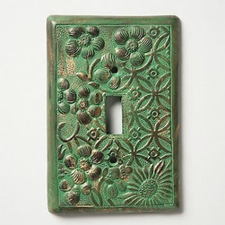 """In Perpetuity Switchplate - Sometimes it's the details that can really make a room. This switchplate, with its patinated finish and botanical-inspired design, could be just the touch to finish a room design in your home.Dimensions: 5.25""""H x 3.5""""W. Made of aluminum."""