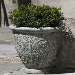Campania International Small Arabesque Cast Stone Planter - About Campania InternationalEstablished in 1984, Campania International's reputation has been built on quality original products and service. Originally selling terra cotta planters, Campania soon began to research and develop the design and manufacture of cast stone garden planters and ornaments. Campania is also an importer and wholesaler of garden products, including polyethylene, terra cotta, glazed pottery, cast iron, and fiberglass planters as well as classic garden structures, fountains, and cast resin statuary.Campania Cast Stone: The ProcessThe creation of Campania's cast stone pieces begins and ends by hand. From the creation of an original design, making of a mold, pouring the cast stone, application of the patina to the final packing of an order, the process is both technical and artistic. As many as 30 pairs of hands are involved in the creation of each Campania piece in a labor intensive 15 step process.The process begins either with the creation of an original copyrighted design by Campania's artisans or an antique original. Antique originals will often require some restoration work, which is also done in-house by expert craftsmen. Campania's mold making department will then begin a multi-step process to create a production mold which will properly replicate the detail and texture of the original piece. Depending on its size and complexity, a mold can take as long as three months to complete. Campania creates in excess of 700 molds per year.After a mold is completed, it is moved to the production area where a team individually hand pours the liquid cast stone mixture into the mold and employs special techniques to remove air bubbles. Campania carefully monitors the PSI of every piece. PSI (pounds per square inch) measures the strength of every piece to ensure durability. The PSI of Campania pieces is currently engineered at approximately 7500 for optimum strength. Each piece is air-dried and then de-molded by hand. After an internal quality check, pieces are sent to a finishing department where seams are ground and any air holes caused by the pouring process are filled and smoothed. Pieces are then placed on a pallet for stocking in the warehouse.All Campania pieces are produced and stocked in natural cast stone. When a customer's order is placed, pieces are pulled and unless a piece is requested in natural cast stone, it is finished in a unique patinas. All patinas are applied by hand in a multi-step process; some patinas require three separate color applications. A finisher's skill in applying the patina and wiping away any excess to highlight detail requires not only technical skill, but also true artistic sensibility. Every Campania piece becomes a unique and original work of garden art as a result.After the patina is dry, the piece is then quality inspected. All pieces of a customer's order are batched and checked for completeness. A two-person packing team will then pack the order by hand into gaylord boxes on pallets. The packing material used is excelsior, a natural wood product that has no chemical additives and may be recycled as display material, repacking customer orders, mulch,or even bedding for animals. This exhaustive process ensures that Campania will remain a popular and beloved choice when it comes to garden decor.Please note this product does not ship to Pennsylvania.