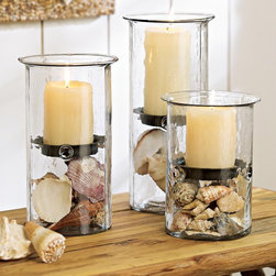 Sarasota Hurricanes - Rustic candle trays update our bestselling hurricanes to coordinate with your natural summer décor. Add seasonal filler under the tray to make this look all your own. Candles not included. Recycled glass and pressed metal.