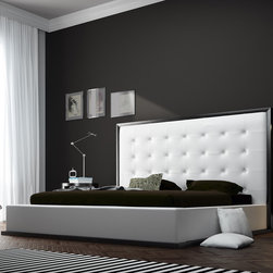 Modloft - Ludlow King Bed in Wenge/White Leather - The awe-inspiring Ludlow eco leather bed commands instant attention when entering a room. The lavish button-tufted headboard stands five feet tall, elegantly framed in a wood border to match any decor. The smooth headboard seamlessly blends into its matching leather base with a wood border along the bottom edge. The mattress sits snuggly atop a solid pine-slat base for stylistic durability and added comfort. Platform height measures 14 inches (3 inch inset). Available in California-King, Eastern (Standard) King, and Queen sizes. Color combinations include Wenge/White, Wenge/Taupe, or Walnut/White. Eco leather material. Assembly required. Mattress not included. Imported.