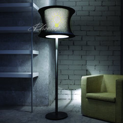 Luz Oculta Tissue Shade Floor Lamp - With simple lines and subtle materials, Luz Oculta plays a game of lights and shadows alternately obscuring and revealing the source of illumination. The floor lamp is available with incandescent or energy-efficient compact fluorescent lamping. Choose Medium or Large shade of Black or White tissue with Anthracite Beech, Decapé Beech or Rusty Steel Stem (pictured).