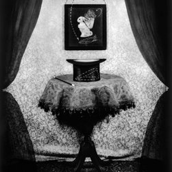 """Hat Trick - Original Fine Art Photography - This limited edition photograph is from a series called, """"That Old Black and White Magic,"""" which depicts wonderful old clich� magic tricks. Pulling a rabbit out of a hat, involves several photographic """"tricks"""" including the suspension of the rabbit and the addition of curtains which were added in the darkroom by artist Carol Golemboski."""