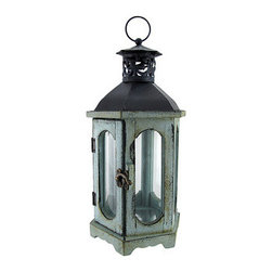 Blue Old World Candle Lantern 14 In. - This candle lantern is a great way to accent and light up your home! With an old world feel, this lantern is great for providing just the right touch and setting the perfect mood. In the front, the lantern features a door fastened by a brass clasp, for easy access to the interior. The interior of this lantern is large enough to fit a candle 6 inches tall and 2 inches wide and features a reflective base to set the candle onto. The lantern is made of polyresin while the top and hanger are both made of metal. Measuring 14 inches tall with 6 equal measuring 3.5 inch side, this lantern is the perfect fit anywhere in the home.