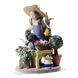 """Lladro Porcelain - Lladro In My Garden Figurine - Plus One Year Accidental Breakage Replacement - """"Hand Made In Valencia Spain - Included with this sculpture is replacement insurance against accidental breakage. The replacement insurance is valid for one year from the date of purchase and covers 100% of the cost to replace this sculpture (shipping not included). However once the sculpture retires or is no longer being made, the breakage coverage ends as the piece can no longer be replaced. """""""