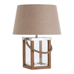 Tate Glass/Wood/Steel/Rope Handle Lamp - Light the way like a sea captain of yore with a romantic lantern-style design, complete with a rope detail. The glass square is anchored to thick wood trim, much like a window, with stainless steel accents for polish. Rugged yet refined, it's finished to perfection with a dark, natural linen shade.