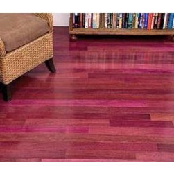 Purpleheart Hardwood Flooring - The breathtaking coloring that has made Purpleheart world famous occurs when its freshly cut brown heartwood is exposed to the air, rapidly turning deep purple. Over time, prolonged exposure to light causes the heartwood to slowly transition from purple to a rich, dark brownish-purple shade. Purpleheart also possesses complimentary tones that can range from pale pink to whitish-grey. Purpleheart is very popular not only because of its amazing color, but also for its high level of durability. This wood serves as stunning decorative accent to any room and is sure to catch the admiring eye of any visitor.