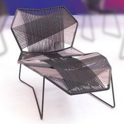 Tropicalia Chaise Chair with Polymer Woven Cord by Moroso - This chair has a serious wow factor. I have seen this design for indoor chairs but had no idea Moroso made them for the outdoors too. I love the weave of the cords into an elegant criss cross pattern that appears to be reinforced in the areas of heaviest uses. The lines of the frame also compliment the pattern of the weave. Very very cool.